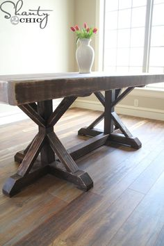 If I didn't inherit my Grandmother's antique heirloom dining table, I would be out in the garage building this right now. {Shanty 2 Chic}