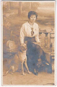 Vintage French real photo postcard, lady with Belgian Shepherd Dog (Malinois)