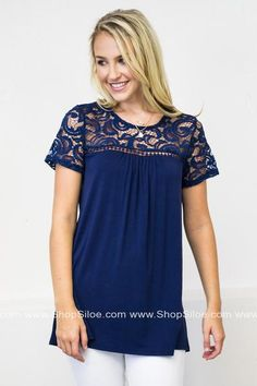 Stay elegant in this beautiful lace top. I love the lace details and soft texture. This navy top features a scoop neck, short sleeves, and lace embellishments. Wouldn't this lovely top look beautiful