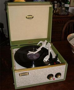 1960s Dansette Tempo portable record player.  Mine was very similar to this - I had to put a coin on the back of the arm to keep it from skipping