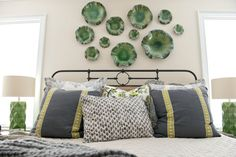 HomeGoods lamps add light and a pop of color to this otherwise neutral bedroom. Sponsored by HomeGoods Happy by Design.