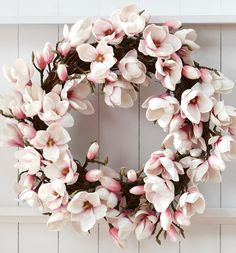 magnolia wreath... But would have to use fake flowers or else it would only be good a few days!