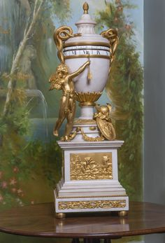 c1900 A Louis XVI style gilt-bronze and white marble cercles tournants mantel clock, French, circa 1900 Estimate   6,000 — 9,000  GBP 7,783 - 11,675USD LOT SOLD. 16,250 GBP (21,080 USD) (Hammer Price with Buyer's Premium)