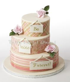 Great use of edible images for the sides of this wedding cake.