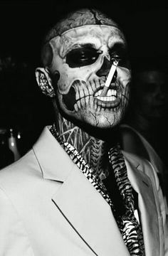 ZOMBIE BOY the face of Derma Blend cosmetics....believe it or not....this guy is hot watch his transformation from zombie boy back to mega hottie on Youtube.com Dermablend Zombie Boy........and yes these tattoos are real