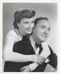 Barbara Stanwyck & Charles Boyer. I simply adore her hair in this shot!
