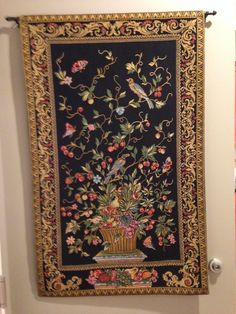 "European Tapestry ""Tree of Life"" Wall Hanging. Bought on Overstock.com - was a perfect fil to cover the circuit breaker panel."