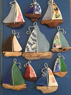 Extremely Large Porcelain and Sea Glass Sailboat Necklace. The left sail is a navy blue and white colored piece of spiral print Porcelain cut and shaped by me using my Dremel. The right sail is a piece of frosted clear glass, collected along the shores of the Chesapeake Bay. The