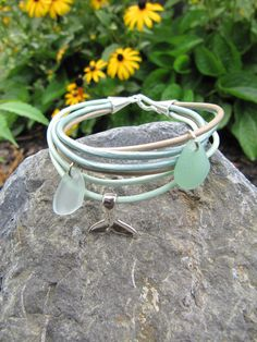 Our Chappy Happy Sea Glass of Smiles bracelet looks perfect on every wrist. Subtle hues of taupe, light and dark mint with two pieces of sea glass is so peacefu