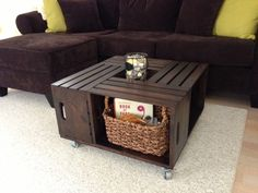 Wooden Crate Coffee Table by Olivabella on Etsy, $400.00 But I can build this for way less than $100. Home Depot has crates for less than $10 a piece.