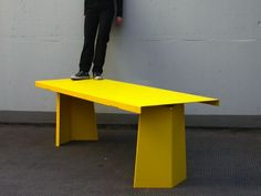 Made from heavy gauge sheet metal PALLAS makes reference to Jean Prouvé's 'Grande table' of the 1950s.
