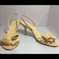 """Kate Spade Gold Leather Slingback Sandals Size 9 Barely Worn Kate Spade Gold Italian Leather Slingback Bow Sandals Size 9 EUC Made in Italy these stunning slingback sandals are in excellent condition in snake embossed gold leather. With a leather sole they have a 3-1/2"""" heel and layered bow peep toe. Perfect for holiday parties or formal wear. Only visible wear is to sole. Please read my seller feedback to get a feeling of comfort prior to bidding. kate spade Shoes Sandals"""