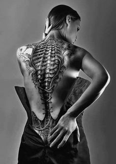 Sic tat. Terminator back. Exactly how my back feels now with the screws, rods, bolts, and major reconstructive work post spinal surgery.