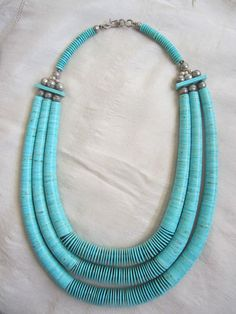 Turquoise 3 strand Vintage Santo Domingo wafer thin heishi necklace. The center beads have small beads between them to produce space them out as seen here.