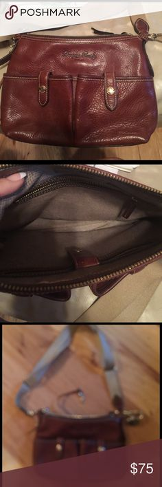 Dooney & Bourke leather handbag. Like new!  Worn slightly smooth on the bottom, otherwise fine.  2 front pockets outside, 2 inside.  Zip top with gold accents.  No dustbag or box. Dooney & Bourke Bags Shoulder Bags