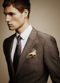 This is a great suit!  Notice the subtle, stylish mismatch of the tie and the pocket square.