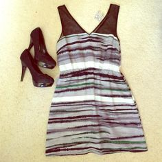 Black, white, green striped dress This is an adorable yet chic dress. Ready for day or night. Black see through tank top like straps. Comfy and dressy at the same time. Dresses