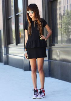 Black peplum dress and Nike wedge sneakers