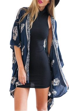 I've been searching for this cardigan for FOREVEER... the one on amazon is a knockoff. Everything about it is perfect from the color to the print and length. Finejo Women Loose Floral Print Kimono Cardigan Blouse Beach Wear Cover Up