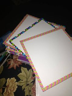 Shower board from Lowes cut down to 12x12 and edges covered in colored duct tape for personal or small dry erase boards