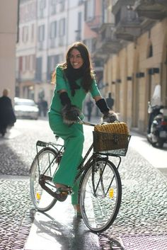 Emerald green on bike. Great color. Works well with our polar queen @helmethuggers http://www.helmethuggers.com/shop/polar-Queen #fashion #cycling #helmethuggers