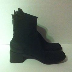 Black Leather Boots Suede feeling leather upper with black leather detailing at heels and back zippers. Upper is in excellent condition. Wear on soles. 2.5 inch stacked heel. Donald J. Pliner Shoes Heeled Boots