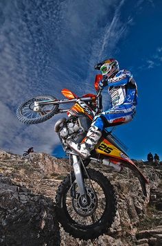 Freestyle Motocross Image, shows a crisp image of what motocross is about. Areas around the motorbike will make for text to be seen well.