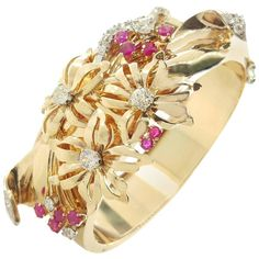 1940s Retro Floral Ruby Diamond Gold Bangle Bracelet    From a unique collection of vintage bangles at https://www.1stdibs.com/jewelry/bracelets/bangles/