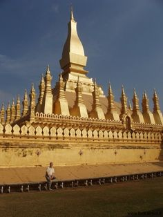 That Luang stupa in Vientiane is the national symbol of Laos shining in gold and covering a smaller stupa with a relic of Buddha himself - from 300 AD.
