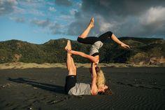 Acro yoga wearing Lhotse organic yoga clothing. Photographed on Karekare bay, New Zealand.
