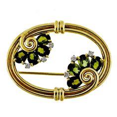 Tiffany & Co. Tourmaline Diamond Yellow Gold Pin. Classic swirl design Art Nouveau influenced slightly rose gold Tiffany & Co fine Tourmaline and diamond pin. Circa 1930.