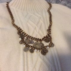 """ANN TAYLOR CHUNKY GOLD COIN NECKLACE love the chic style of this two-tiered, gold tone chain featuring dangling coins in a stylish antiqued patina. Toggle clasp closure. Imported 32"""" end to end Excellent condition. Ann Taylor Jewelry Necklaces"""