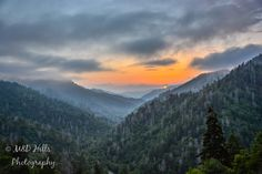 In the beginning the clouds veiled the mountains, but just as the sun began to set, the clouds lifted to reveal one of the best sunsets we'd ever taken.  By M&D Hills Photography.  http://blueridgemountainlife.com/behind-photos-m-d-hills-photography/