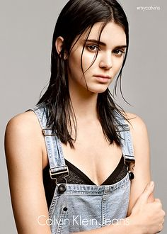 Kendall Jenner rocks wet hair, a perforated bra, and overalls in her new Calvin Klein Jeans campaign.
