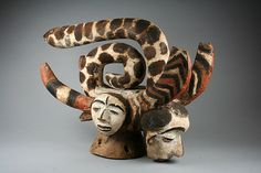 Headdress: Snakes and Heads (Idire) Artist: Oba of Otobi Date: 1955 Geography: Nigeria, Benue River Valley region Culture: Okpoto peoples, Idoma group Medium: Wood, pigment Dimensions: H. 18 11/16 x W. 7 1/2 x D. 13 in. (47.5 x 19.1 x 33 cm)