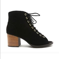 """•SALE• Black lace up booties This pair is timeless, and the best addition to your closet. This style features a suede leatherette upper , peep toe, perforate details, lace up from front to ankle ,stacked heel with a lightly padded insole for your comfort. ONLY IN BLACK   Size 6 fits a 6.5 and size 7 fits a size 7.5   Material: Man made, leatherette Sole: Synthetic Measurement:  Heel Height: 2 1/2"""" (approx) Fitting: ORDER 1/2 SIZE SMALLER   💢PRICE IS FIRM💢 Qupid Shoes Ankle Boots & Booties"""