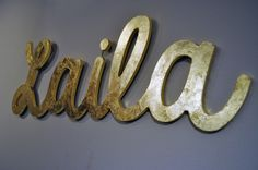 Custom name sign in gold or silver script font (5 letters) - metallic wall hanging for kids bedroom, nursery, playroom custom made. $100.00, via Etsy.