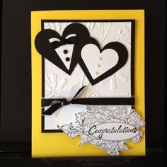 Wedding congratulations handmade card with hearts and ribbon  Yellow cardstock w/ black & white, embossed daisy background. $3.50, via Etsy.