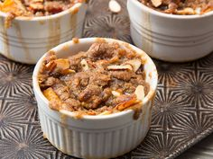 peach cobbler Loaded with peaches baked with a light syrup and topped with a roasted almond streusel.