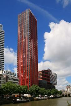 The development consists of two major volumes – a tower of 124 meters height and a partly cantilevering block building, both connected by a plinth with public functions as integral part of the existing surroundings. All 231 apartments provide forpanoramic views and the red bands of the façade accentuate the Red Apple in the skyline of Rotterdam.