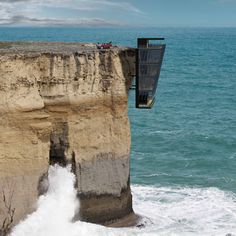 "Vertiginous Cliff House by Modscape designed to hang off a precipice like ""barnacles clinging to a ship's hull"""