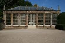 """Montachute House Orangery, England, built by 1840. It was recorded in a bound folio belonging to Mr David Phelips from that time, entitled """"the new garden glasshouse"""". The story may start earlier than this as the west wall seems to pre date any other outer wall and through Edward Phelips' diaries in 1778, hinting that Orange trees were taken out into the gardens in the summer, it would follow that another building of this nature was perhaps located where the Orangery is situated."""