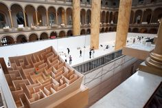 The Beach from above, seen behind a model of Bjarke Ingels Group (BIG)'s MAZE;—last summer's installation at the museum.