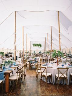 At this Aspen wedding, the couple concentrated on the bottom of the tent, setting up wood flooring and covering tabletops with pretty blue linens and glassware. It's a refreshing take on tent decor because it lets the beauty of the simple, sailcloth tent shine.