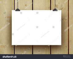 #Blank #poster #frame with #clips on vertical #brown #wooden #boards #background