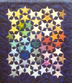 What a beautiful quilt!  Lies (pronounced 'lease') created this repeating star block pattern and filled it full of a broad spectrum of colors.  Get the free pattern: www.freequiltpatterns.info/free-pattern---cosmosdust-quilt-by-lies-bos-varkevisser.htm