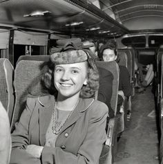 """Shorpy Historical Photo Archive :: Going Places: 1943 :: September 1943. """"A Greyhound bus trip from Louisville to Memphis and the terminals. Roberta Locker, going to Chattanooga from Elora, Tenn., to work."""" Co-starring Roberta's hat, an elaborate construction of netting, fabric and feathers. Photo by Esther Bubley for the Office of War Information."""
