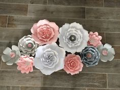 Paper Flower backdrop Pink, white, grey, and silver (set of 10) by AbbieLuHandmade on Etsy https://www.etsy.com/listing/478681086/paper-flower-backdrop-pink-white-grey