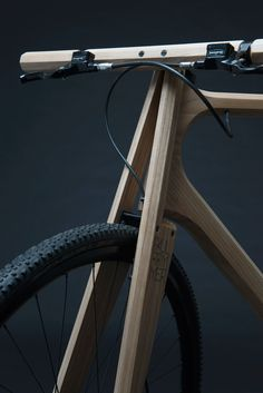 Wooden bike with unique fork construction.