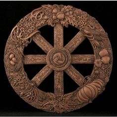 """Wheel of the Year"" Wall Plaque - by Maxine Miller ~~ Wood finish. Exquisitely crafted, 12"" in Diameter.  This beautiful ""Wheel of the Year"" plaque displays the eight festival days of Paganism, Wicca, and Witchcraft.      A unique feature of this piece is a circle of eight hooks on the back that allows the plaque to be ""turned"" with the changing of the Season allowing it to appear on top of the Wheel of the Year."